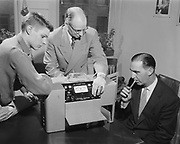 """Y-560301A-1 Alcoholics test. Oregon State center. March 1, 1956"""" published in Oregonian 3/4/56 pg. 32 """"The 'Alcometer' is explained to Tony Lukes, Lincoln high, by Berian Lemon, executive of the Oregon Alcoholic Rehabilitation clinic (center) and Gordon Raney, assistant director."""""""