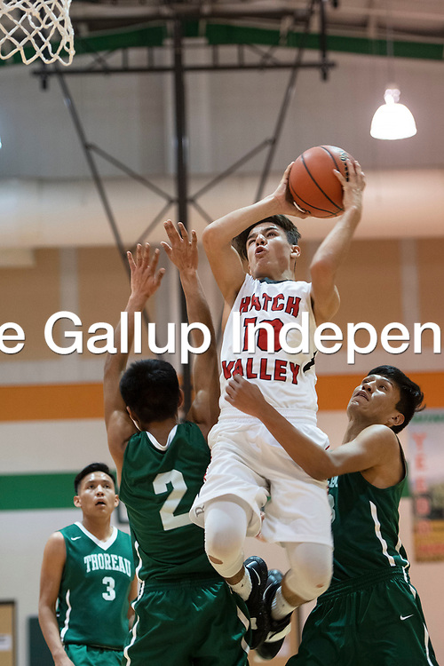 Oscar Gonzalez (10) drives to the basket for Hatch Valley in their game against Thoreau, Saturday, Dec. 15 in the Wingate Holiday Classic, at Wingate High School.