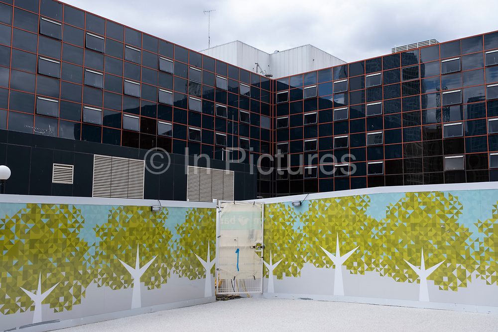 Tree hoarding at Chamberlain Square which is under redevelopment as the Coronavirus lockdown continues, the city centre is still very quiet on 28th July 2020 in Birmingham, United Kingdom. Paradise, formerly named Paradise Circus, is the name given to an area of approximately 7 hectares in Birmingham city centre between Chamberlain and Centenary Squares. The area has been part of the civic centre of Birmingham since the 19th century. From 2015 Argent Group will redevelop the area into new mixed use buildings and public squares.
