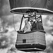 Four people clearly enjoying themselves in the basket.  I'm not sure how far they went or how high.  Someday maybe I'll be able to do that!<br /> <br /> I've done this image in both color and black and white.  The differences are remarkable.  My family and friends are evenly divided as to which they prefer.  Which do you like better?