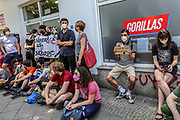People protest against the laying-off of a Gorilla Delivery Company employee outside the company's warehouse in Berlin in Berlin, Germany, June 10, 2021. The demonstrators demanded the re-hiring of an employee named Santiago, claimed to be fired during a probation period in the company, calls for additional employees rights were also heard.