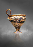 Minoan clay cup decorted design, Speial Palatial Style , Knossos Palace 1500-1450 BC BC, Heraklion Archaeological  Museum, grey background. .<br /> <br /> If you prefer to buy from our ALAMY PHOTO LIBRARY  Collection visit : https://www.alamy.com/portfolio/paul-williams-funkystock/minoan-art-artefacts.html . Type -   Heraklion   - into the LOWER SEARCH WITHIN GALLERY box. Refine search by adding background colour, place, museum etc<br /> <br /> Visit our MINOAN ART PHOTO COLLECTIONS for more photos to download  as wall art prints https://funkystock.photoshelter.com/gallery-collection/Ancient-Minoans-Art-Artefacts-Antiquities-Historic-Places-Pictures-Images-of/C0000ricT2SU_M9w