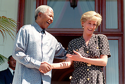 SOUTH AFRICAN PRESIDENT NELSON MANDELA MET PRINCESS DIANA AT ONE OF HIS OFFICIAL HOMES IN RONDEBOSCH, MONDAY 17/3/1997. \'I AM THRILLED TO MEET YOU\', SHE SAID. \'YOUR\'E BEAUTIFUL\' HE TOLD HER BUT DECLINED TO KISS HER SAYING \'THAT WOULD BE TREASON\'. <br /> PIC BENNY GOOL.  EDS NOTE FEE 2000 US DOLLARS.