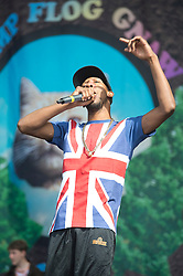 © London News Pictures. 25/08/2012. Reading, UK. Left Brain (union Flag top) performing with Odd Future' on the main stage on day two of Reading Festival 2012 in Reading, Berkshire, UK on August 25, 2012. The three day event which attracts over 80,000 music fans headlines The Cure, Kasabian and The Foo Fighters Photo credit : Ben Cawthra/LNP