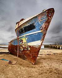Derelict hull of a coaster wreck on the beach at Instow in Devon. Named as the S.S. Boop in graffiti.