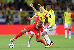 England's Harry Kane (left) and Colombia's Wilmar Barrios battle for the ball during the FIFA World Cup 2018, round of 16 match at the Spartak Stadium, Moscow.