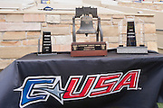 Dec 1, 2012; Tulsa, Ok, USA; An MVP trophy Liberty bowl trophy and CUSA trophy sit on a table during a game between the Tulsa Hurricanes and the University of Central Florida Knights at Skelly Field at H.A. Chapman Stadium. Tulsa defeated UCF 33-27 in overtime to win the CUSA Championship. Mandatory Credit: Beth Hall-USA TODAY Sports