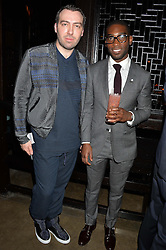Left to right, designer JAMES LONG and TINIE TEMPAH at a dinner hosted by Anya Hindmarch and Dylan Jones to celebrate the end London Collections: Men 2014 held at Hakkasan, 8 Hanway Place, London on 8th January 2014.