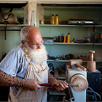 083013       Brian Leddy<br /> David Baker spins a bowl on a lathe in his Fort Wingate wood shop Friday. Baker recently retired and has been spending a in his shop.