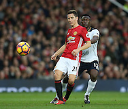 Ander Herrera of Manchester United tussles with Victor Wanyama of Tottenham during the English Premier League match at Old Trafford Stadium, Manchester. Picture date: December 11th, 2016. Pic Simon Bellis/Sportimage