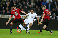 Neil Taylor of Swansea city © has a shot at goal. Barclays Premier league match, Swansea city v West Bromwich Albion at the Liberty Stadium in Swansea, South Wales  on Boxing Day Saturday 26th December 2015.<br /> pic by  Andrew Orchard, Andrew Orchard sports photography.