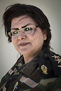 Sulaymaniyah, Iraq - <br /> <br /> Female Fighters of The Peshmerga<br /> As ISIS has swept across northern Iraq, they have become known for their atrocities towards women. However, there's a group of women that aren't preparing to flee ISIS but instead are preparing to meet them with their AK-47s. The 2nd Peshmerga, are a battalion of Kurdish fighters 'Äì and they just happen to be an all-female soldiers. They're front line troops, some of whom have been fighting for years, and they are eager to face ISIS. Dressed in army fatigues and armed with rifles, they are ready to lay down their lives to protect the Kurdish homeland against the threat of ISIS. They carry out training exercises and look no different from other Kurdish soldiers - except for a hint of makeup on some faces and long hair escaping from their caps. The 2nd Battalion consists of 550 mothers, sisters and daughters and was formed in 1996. Over the past month, they have moved into disputed areas abandoned by Iraqi security forces during the Isis advance. They have also recently seized control of oil production facilities at Bai Hassan and Kirkuk - the female Peshmerga will now be part of a mission to secure the city and its surrounding oil fields.<br /> <br /> Portrait of 2nd Battalion's Lieutenant JWAN.<br /> ©Excluisvepix Media