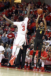 14 February 2015:   Daishon Knight attempts to block a shot offered by Cory Henderson Jr. from just inside the 3 point line near the Redbird bench during an NCAA MVC (Missouri Valley Conference) men's basketball game between the Wichita State Shockers and the Illinois State Redbirds at Redbird Arena in Normal Illinois