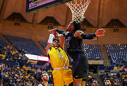 Mar 20, 2019; Morgantown, WV, USA; West Virginia Mountaineers forward Emmitt Matthews Jr. (11) shoots in the lane during the second half against the Grand Canyon Antelopes at WVU Coliseum. Mandatory Credit: Ben Queen