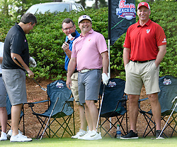 Georgia head football football coach Kirby Smart and North Carolina State head football coach Dave Doeren during the Chick-fil-A Peach Bowl Challenge Closest to the Pin Skills Competition at the Ritz Carlton Reynolds, Lake Oconee, on Monday, April 29, 2019, in Greensboro, GA. (Dale Zanine via Abell Images for Chick-fil-A Peach Bowl Challenge)
