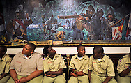 Xavier Mascareñas/Treasure Coast Newspapers; Joseph Jean, 12, looks up at a painting in the Florida House of Representatives floor as he waits to lead the Pledge of Allegiance with fellow members from Boy Scout Troop 772 of Fort Pierce at the Florida Capitol in Tallahassee on April 3, 2014. The boys met with their State Rep. Larry Lee Jr., D-Fort Pierce, and voiced their concerns about gun and gang violence in Fort Pierce.