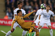 Dele Alli of Tottenham Hotspur gets to the ball ahead of Kyle Naughton of Swansea city and tries an overhead kick but misses the goal. Premier league match, Swansea city v Tottenham Hotspur  at the Liberty Stadium in Swansea, South Wales on Wednesday 5th April 2017.<br /> pic by Andrew Orchard, Andrew Orchard sports photography.