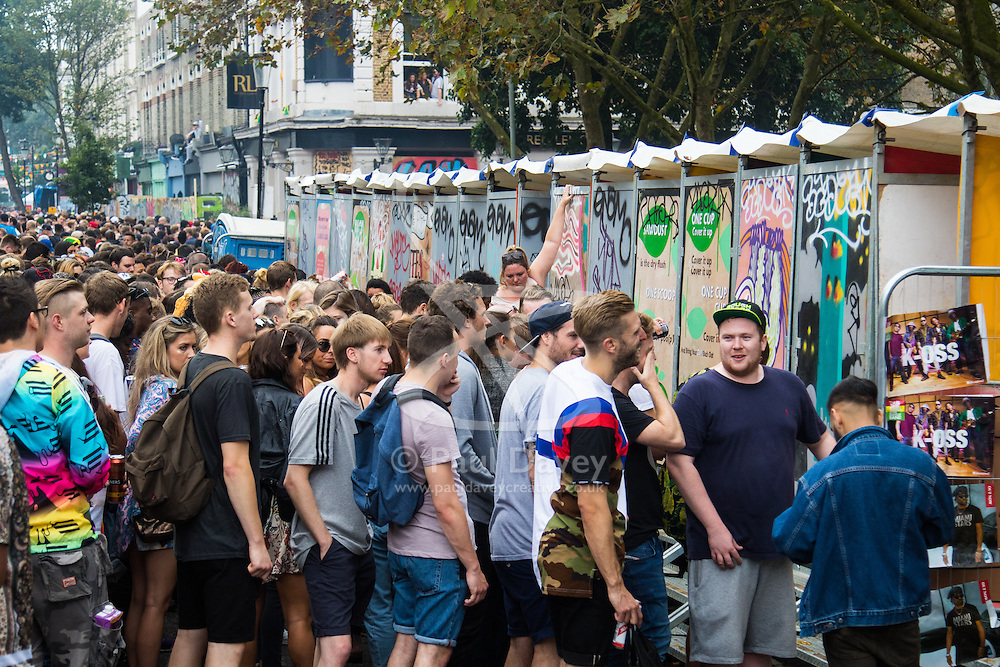 London, August 28th 2016. Hundreds of portable toilets are provided for the revellers, but still the queues force some to relieve themselves in the streets during Family Day at Europe's biggest street party, the Notting Hill Carnival.