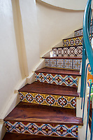 Spanish Colonial Stairway - A flight of stairs is a run steps between landings. A staircase is one or more flights of stairs leading from one floor to another.  These include: landings, balustrades,  handrails and newel posts. building.