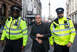 London, UK. 16 October, 2019. Police officers arrest Jonathan Bartley, co-leader of the Green Party, who had defied the Metropolitan Police prohibition on Extinction Rebellion Autumn Uprising protests throughout London under Section 14 of the Public Order Act 1986 by sitting in the road in Whitehall.
