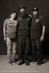 Paughco's custom bike builder Kyle Brewer (R) with Jennifer and Glen King at the Easyriders party in the VIP area of the Full Throttle Saloon as Cheap Trick played the main stage during the Sturgis Black Hills Motorcycle Rally. Sturgis, SD, USA. Tuesday, August 6, 2019. Photography ©2019 Michael Lichter.