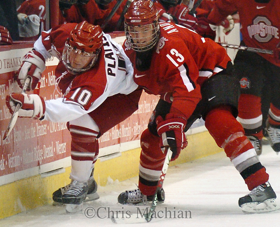 2/17/07 Omaha NE University of Nebraska  at Omaha's J.P. Platisha steals the puck from  Ohio State University's Bryce Anderson during the second period  at the Omaha Civic Auditorium Saturday evening. (photo by Chris Machian/ Prairie Pixel Group)
