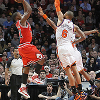 12 March 2012: Chicago Bulls guard Jimmy Butler (21) takes a jumpshot over New York Knicks point guard Baron Davis (85) and New York Knicks center Tyson Chandler (6) during the Chicago Bulls 104-99 victory over the New York Knicks at the United Center, Chicago, Illinois, USA.