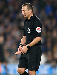 EDITORS NOTE: EXPLICIT CONTENT<br /><br />Referee Kevin Friend retrieves an item that was thrown on to the pitch during the match