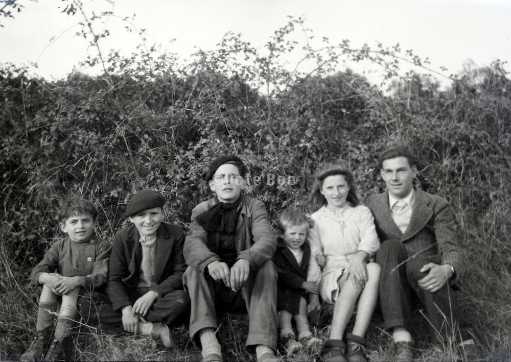adult male person posing with various aged children