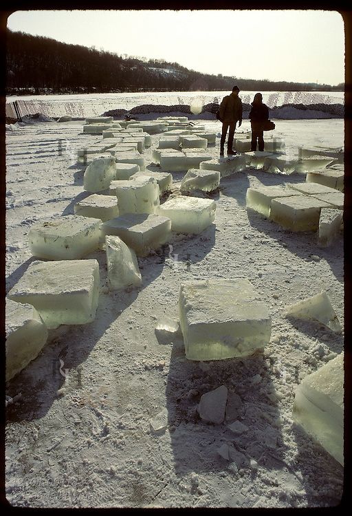 Two men survey the ice blocks cut from Pickerel Lake for ice sculptures;St Paul Wntr Carnival Minnesota