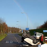Ongeval Merk Huizen, smart over de kop, regenboog