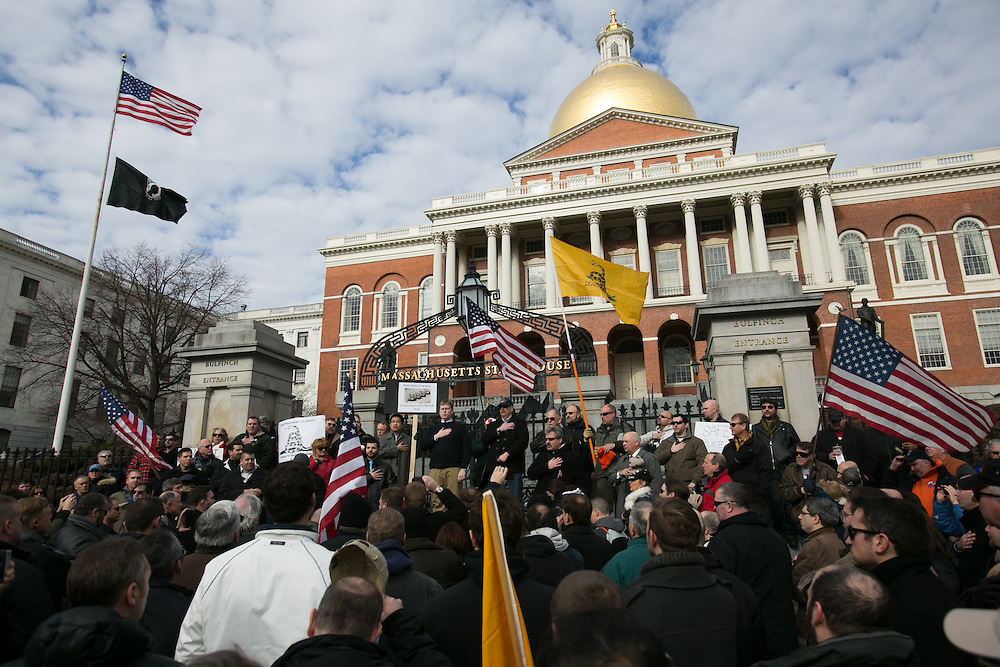 Boston, MA 01/19/2013.Gun rights supporters recite the national anthem as they gather on the steps of the Massachusetts State House on Saturday as part of a coordinated nationwide movement against proposed gun control legislation..Alex Jones / www.alexjonesphoto.com