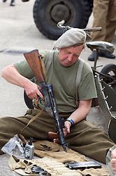 A reenactor portraying a member of the 1st (Polish) Independent Parachute Brigade cleans a personal weapon at the Elsecar 1940s Weekend <br /> 4 September 2010 <br /> Images © Paul David Drabble