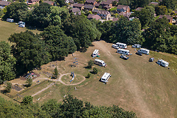 © Licensed to London News Pictures. 28/06/2018. Fetcham, UK.  Traveller caravans and other vehicles occupy a football field and children's play area at Fetcham Recreation ground. The site was occupied by 18 vehicles on Wednesday 27th June and the occupants were issued with a Notice of Direction requesting that they leave by Mole Valley District Council. This has been ignored and the council went to court to seek further legal action yesterday (28th June 2018). Photo credit: London News Pictures