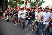 Students demonstrate against austerity measures and planned education reforms in Athens. The demonstration is against an education reform bill which aims to improve the operation of universities. The protesters formed a human chain with arms and red flags linked as they walked through the streets chanting slogans.