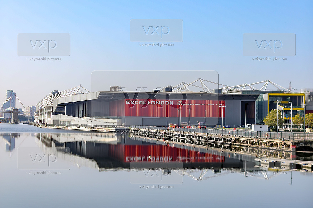 Nearly deserted former makeshift Hospital Nightingale at the Excel London exhibition centre is seen reflected in the waters of River Thames on Monday, Sept 21, 2020. Britain's PM Boris Johnson is preparing to chair a Cobra emergency committee meeting on Tuesday morning, following a statement from government's chief scientific adviser Sir Patrick Vallance who warned that the UK could see 50,000 new coronavirus cases a day by mid-October without further action. On Sunday, further 3,899 daily cases and 18 deaths were reported in the UK. (VXP Photo/ Vudi Xhymshiti)