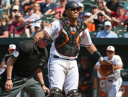 June 4, 2017 - Baltimore, MD, USA - Baltimore Orioles catcher Francisco Pena reacts after his throwing error allows the Boston Red Sox's Mitch Moreland and Jackie Bradley to score the go-ahead runs in the sixth inning on Sunday, June 4, 2017 at Oriole Park at Camden Yards in Baltimore, Md. (Credit Image: © Kenneth K. Lam/TNS via ZUMA Wire)