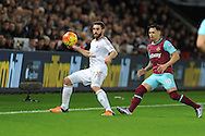Angel Rangel of Swansea city (l) shields the ball from Mauro Zarate of West Ham Utd.Barclays Premier league match, Swansea city v West Ham Utd at the Liberty Stadium in Swansea, South Wales  on Sunday 20th December 2015.<br /> pic by  Andrew Orchard, Andrew Orchard sports photography.