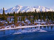Ice on Jarvis Creek, the Saint Elias Mountains beyond, Yukon Territory, Canada.