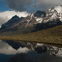 The Horns of Paine and Monte Almirante Nieto reflect in a tarn in Torres del Paine National Park in Patagonia, Chile.