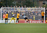 Oxford United midfielder Alex MacDonald (11) scores a goal to make it 1-0 leaving Merstham Goalkeeper Phil Wilson unable to stretch far enough to stop it during the FA Cup match between Merstham and Oxford United at Moatside, Merstham, United Kingdom on 5 November 2016. Photo by Andy Walter.