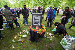 © Licensed to London News Pictures; 25/05/2021; Bristol, UK. A vigil is held for George Floyd on College Green, part of a series of vigils around the UK and world on the anniversary of his murder. George Floyd was a black man who was killed on May 25, 2020 in Minneapolis in the US by a white police officer Derek Chauvin kneeling on his neck for nearly 9 minutes. The killing of George Floyd saw widespread protests in the US, the UK and other countries. Two weeks later on 07 June 2020 the statue of slave trader Edward Colston in Bristol city centre was pulled down with ropes and thrown into Bristol docks during an All Black Lives/Black Lives Matter protest. Photo credit: Simon Chapman/LNP.