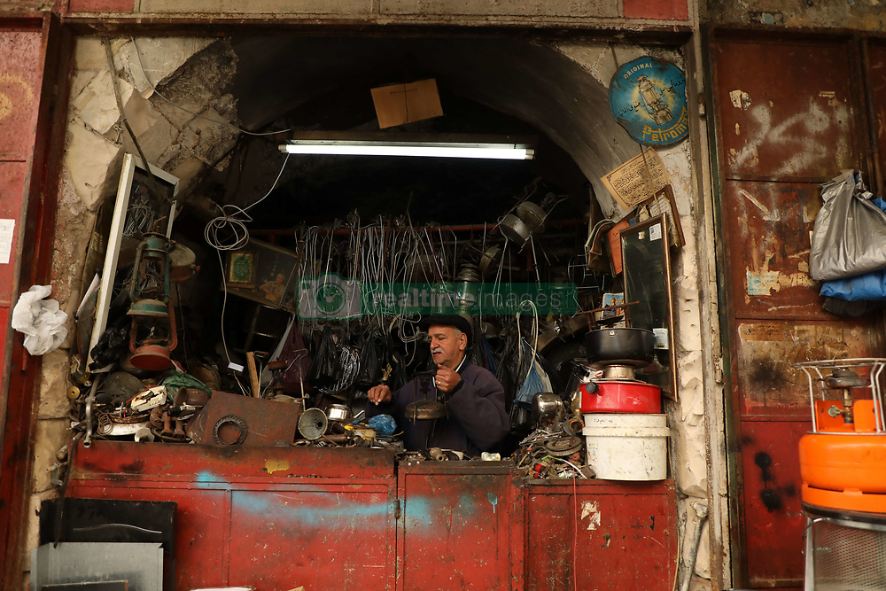 March 27, 2019 - Mouhi Aldein Hashhush repairs traditional paraffin cooking stoves and lamps in his workshop in the Old City of Nablus, where he has been working during the last 37 years. The labyrinth of cobbled streets of Nablus' Old City bustles with numerous shops but also with workshops employing traditional techniques passed through generations. The traditional workshops blend with the rich history of the Old City which dates from the Ottoman era but goes also back to the Romans and manifests itself in its distinct stone facades, beautiful architecture, cobbled streets and dense architectural fabric. The historic importance and architectural beauty of Nablus' Old City have been highlighted by UNESCO (Credit Image: © Mohammed Turabi/IMAGESLIVE via ZUMA Wire)