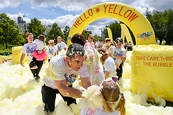 © Licensed to London News Pictures. 21/05/2017. London, UK. People take part in The Bubble Rush held at the Olympic Park in East London.  Participants run/walk the 5km course passing through a pink, yellow, green and blue bubble machine raising funds for local charities. Photo credit : Stephen Chung/LNP