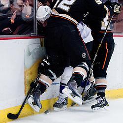 Brad Richardson (Los Angeles Kings, #15) crushed by Toni Lydman (Anaheim Ducks, #32) during ice-hockey match between Anaheim Ducks and Los Angeles Kings in NHL league, Februar 23, 2011 at Honda Center, Anaheim, USA. (Photo By Matic Klansek Velej / Sportida.com)
