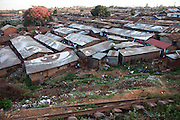 Nearly a million people live in makeshift houses made of plastic, cardboard and corrugated iron sheets in Kibera slum, Africa's largest slum settlement located in Nairobi, Kenya.  Providing affordable housing remains one of the key challenges of the Kenyan government.