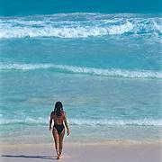 Woman entering the ocean..Cancun,Q.Roo.Mexico.