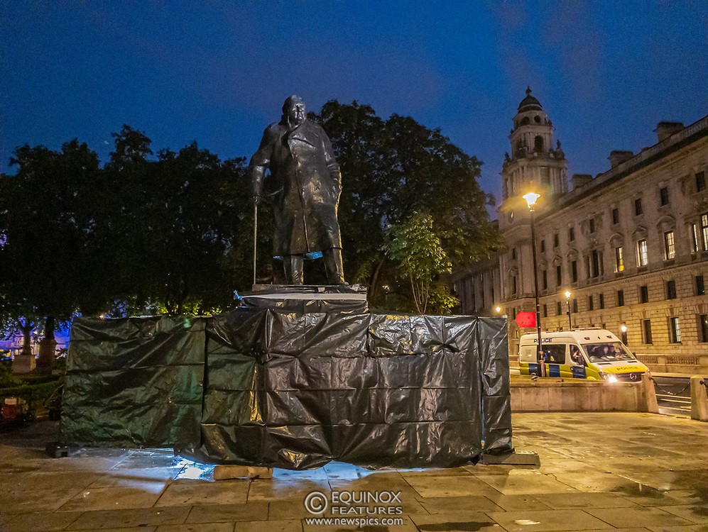 London, United Kingdom - 17 June 2020<br /> Police guard Winston Churchill statue. Its graffiti was being cleaned with solvents after the statue was uncovered from its protective scaffolding and sheet metal following Black Lives Matter protests, Parliament Square, London, England, UK.<br /> (photo by: EQUINOXFEATURES.COM)<br /> Picture Data:<br /> Photographer: Equinox Features<br /> Copyright: ©2020 Equinox Licensing Ltd. +443700 780000<br /> Contact: Equinox Features<br /> Date Taken: 20200617<br /> Time Taken: 22245837<br /> www.newspics.com