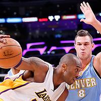 23 November 2014: Los Angeles Lakers guard Kobe Bryant (24) drives past Denver Nuggets forward Danilo Gallinari (8) during the Los Angeles Lakers season game versus the Denver Nuggets, at the Staples Center, Los Angeles, California, USA.