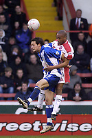 Photo. Glyn Thomas.<br /> Sheffield United v Colchester. FA Cup fifth round.<br /> Bramall Lane, Sheffield. 15/02/2004.<br /> Colchester's Thomas Pinault (L) fights an aerial battle for possession with Sheffield's Mark Rankine.